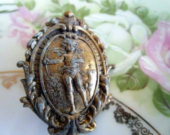 Vintage Brass stamped Cherub Brooch With green patina