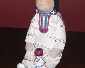 Handmade figurine of a Native American  woman and her children