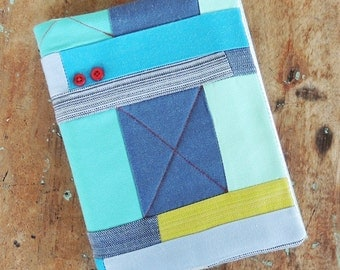 Journal, note book, graphic blue fabric cover, unique with red button feature