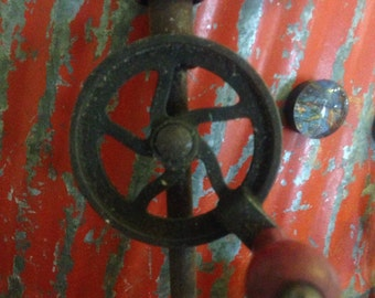 Primitive old antique drill with gears
