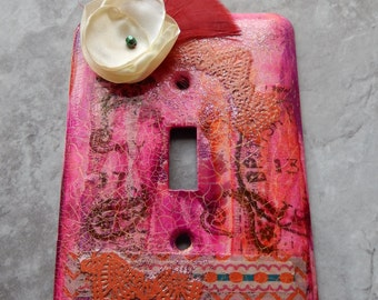 Paisleys and Posies, mixed media, light switch cover, collage, fabric flower and dark pink feather