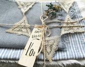 Vintage blanket patchwork quilt fragments, linen, antique diamante brooch, handmade paper rose- bundle of possibilities