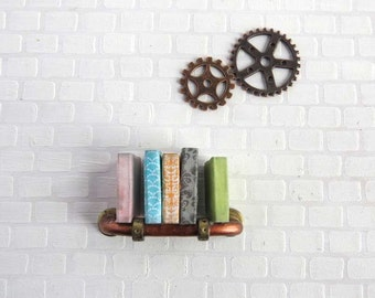 Steampunk bookcase with books on a pipe  in 1:12 scale