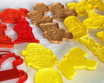 Vintage WILTON plastic Cookie Cutters • Lot of 19 • Sesame Street, Nintendo, Bears, Easter