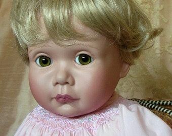 Porcelain baby doll made by Emily Hart Grandmaster of Dollmaking