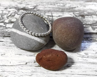 Silver beaded stacking ring.