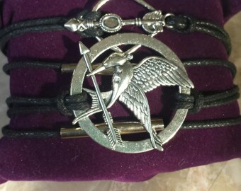 Hunger games multi strand bracelet,large  mockingjay, bow and arrow, symbol of rebellion, black and silver tone, charm, charms, bracelet