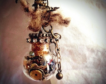 Steampunk Inspired Glass Bottle containing watch parts Pendant Necklace