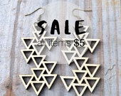 Triangles in composition earrings.