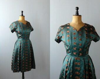 Vintage 1950s dress set. 50s iridescent deep green satin dress and jacket suit. brass embroidery dress set