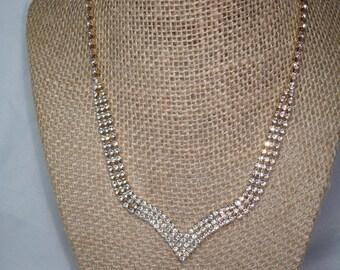 1980s Gold Tone Rhinestone V Shaped Necklace.