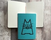 Small blank journal in turquoise featuring Dave the cat - hand-printed, hand-stitched A6 pocket sized holiday notebook