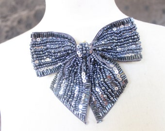Cute  beaded and   embroidered bow  applique with  sequence    1 pieces listing