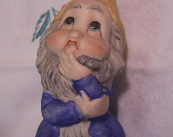 adorable little thinking gnome figurine