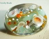 Handmade Lampwork Focal bead 'Pale Green & Orange' Creeky Beads SRA