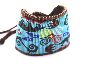 Beaded Wolf and Bear Claw Medicine Wheel Bracelet on Chocolate Deer Hide for Men and Women