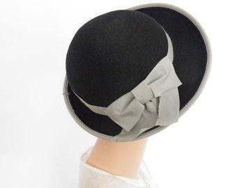 Bowler tilt hat, vintage black with gray trim.
