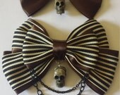 2 brown bows with skulls