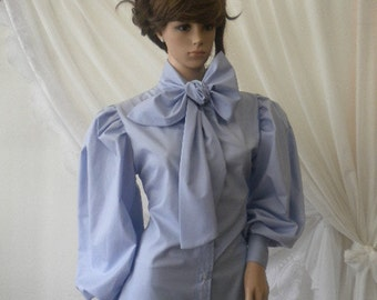 Ladies shirt with blue ribbon and puffed sleeves made of cotton