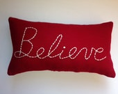 BELIEVE Deep Red Wool Pillow for Instant Inspiration