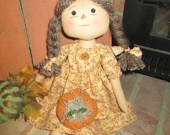 Simple Prim Raggedy Ann with pumpkin