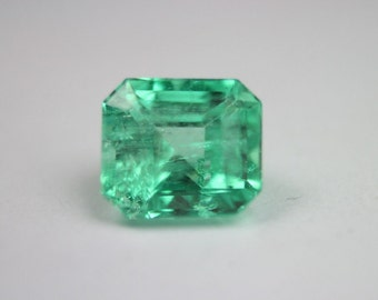 2.05 cts effulgent slightly yellowish green natural Colombian emerald cut