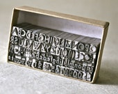Small Vintage Letterpress Type with Uppercase, Lowercase, Numbers and Extensive Punctuation for Printing and Stamping