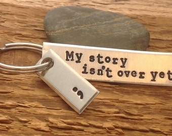 "Hand stamped ""My story isn't over yet"" semicolon project keychain"