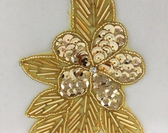 Gold sequin and bead flower with rhinestone center