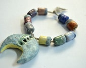 Truthed into peace -- a set of 9 small colorful beads and a pendant