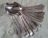 Eleven Wm. Rogers & Son Silverplate Teaspoons 1894 ' Florida '