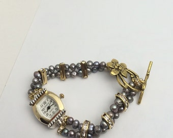 Double stranded watch/Bracelet, black pearls, gold tone, clear rhinestones spacers, item no D113