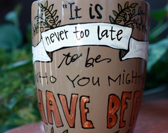 "George Eliot ""It is never too late to be who you might have been"" Hand painted literary quote mug - Large, mocha brown mug with banner"