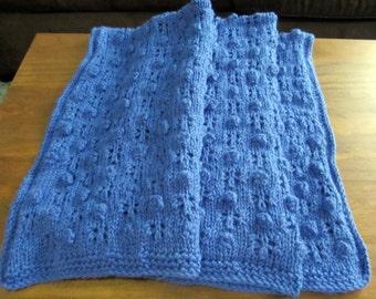 Bobbles in blue baby blanket