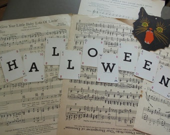 Halloween spelled with vintage game card letters