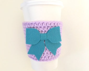 Purple coffee cozy with bow. Starbucks coozie sleeve