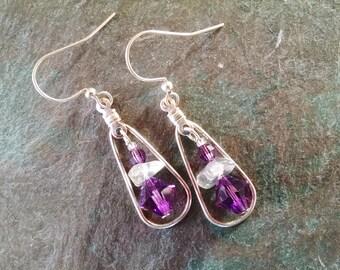 Silver teardrop hoop earrings with purple crystal