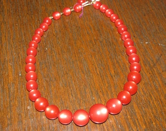 1940s or 50s cherry red moonglow graduated bead choker. Hook and chain bead closure