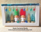 Troll Angels Christmas - small wood diorama. Red and green haired troll doll angels, mini trees, Christmas lights. White and green.