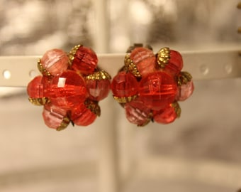 vintage clip on earrings in reds, and pink beads in a gold setting