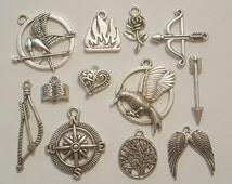 12pcs Hunger Games Theme Tibetan Silver Charms pendants for jewellery making Including Mockingjay Bird, Bow and Arrow, Compass, Fire, Wings