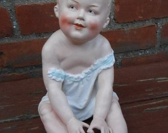 Reserved ..... Antique Gebruder Heubach Bisque Porcelain Piano Baby