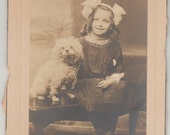 Vintage/Antique cabinet photo of a beautiful girl and her cute puppy