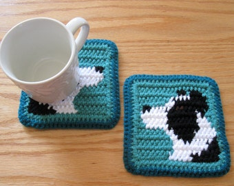 Border Collie Coasters. Teal and jade, crochet dog coaster set with black and white collies.