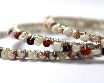 Set of three beaded bangle bracelets