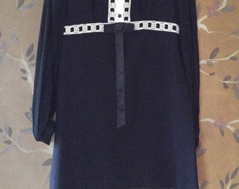60s black mod mini dress with long sheer sleeves and decorative trim front