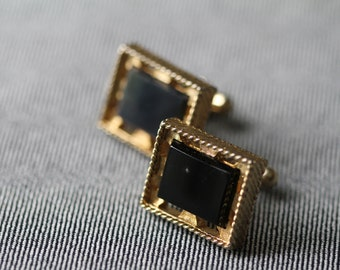 Vintage gold tone cuff links with black stone settings