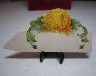 Unused 1910's-20's colorful die cut yellow chrysanthemum flower place card