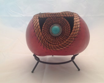 Gourd with turquoise colored stone