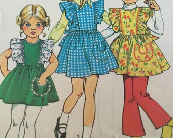 Simplicity 5816 Girls vintage pinafore dress or jumper pattern, 1970s dress with cute horseshoe pocket and frilled shoulders,  size 3 or 4